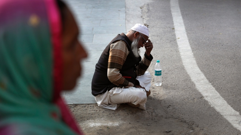 An elderly Indian Muslim, who lost two nephews in a fire, wait to receive the bodies in a mortuary in New Delhi, India, Sunday, Dec. 8, 2019. (AP Photo/Manish Swarup)