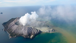 This aerial photo shows White Island after its volcanic eruption in New Zealand Monday, Dec. 9, 2019. (George Novak/New Zealand Herald via AP)