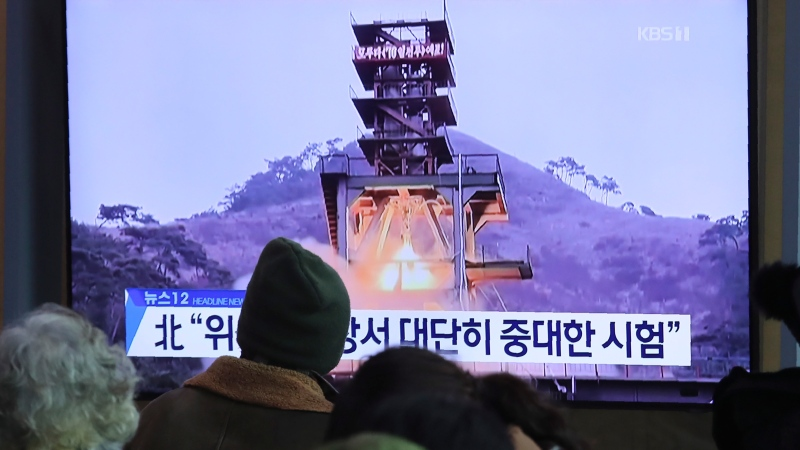 People watch a TV screen showing a file image of a ground test of North Korea's rocket engine during a news program at the Seoul Railway Station in Seoul, South Korea, Monday, Dec. 9, 2019. (AP Photo/Ahn Young-joon)