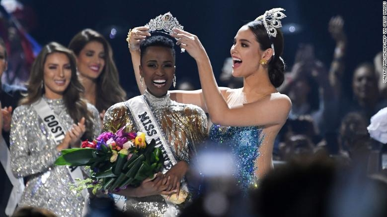 Miss Universe 2018 Catriona Gray of the Philippines crowns the new Miss Universe 2019, South Africa's Zozibini Tunzi, during the pageant at Tyler Perry Studios in Atlanta, Georgia, on December 8, 2019. (CNN)