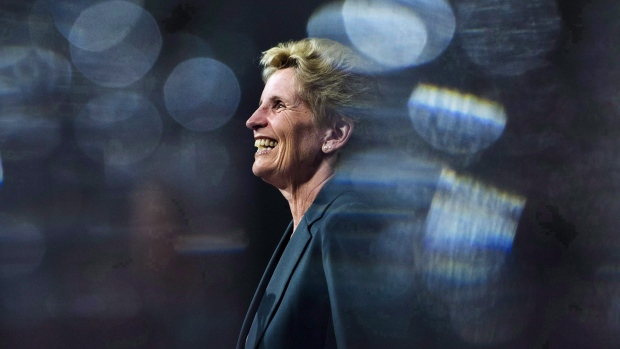 Ontario Liberal Leader Kathleen Wynne is pictured between glasses as she speaks during a campaign stop at Crosscut Distillery in Sudbury, Ont., on Wednesday, May 23, 2018. The official portrait of Ontario's first female premier is set to be unveiled at the legislature later today. THE CANADIAN PRESS/Nathan Denette