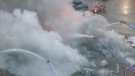 Fire crews are seen battling a massive fire at an industrial building in Schomberg. (CTV News Toronto)