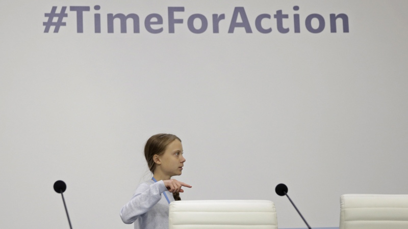 Climate activist Greta Thunberg arrives for a news conference at the COP25 Climate summit in Madrid, Spain, on Dec. 9, 2019. (Andrea Comas / AP)