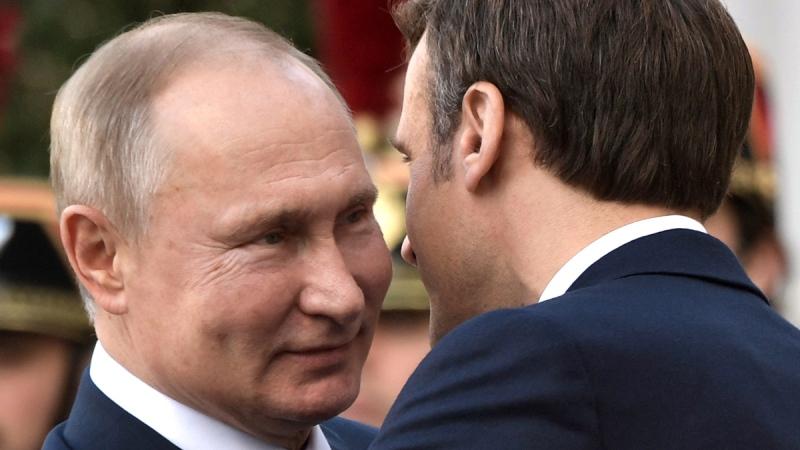 French President Emmanuel Macron, right, welcomes Russian President Vladimir Putin at the Elysee Palace, in Paris, on Dec. 9, 2019. (Alexei Nikolsky, Sputnik, Kremlin Pool Photo via AP)