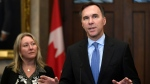 Minister of Finance Bill Morneau and Minister of Middle Class Prosperity and Associate Minister of Finance Mona Fortier make an announcement on lowering taxes for the middle class in the Foyer of the House of Commons on Parliament Hill in Ottawa, on Monday, Dec. 9, 2019. THE CANADIAN PRESS/Justin Tang