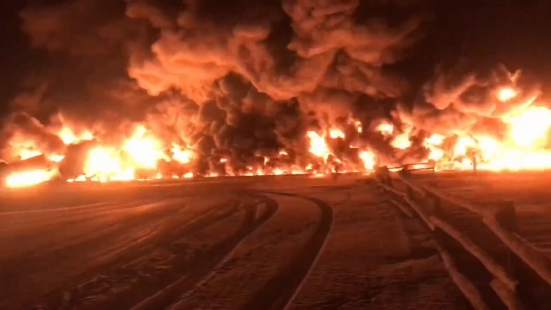 A Canadian Pacific freight train hauling crude derailed overnight just west of Guernsey, sparking a fire. (Melanie Loessl/Facebook)