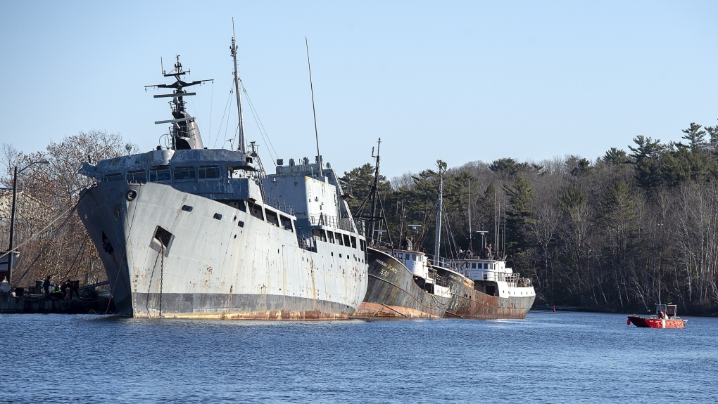 Coast guard begins work to secure derelict ship that risks polluting N.S. river