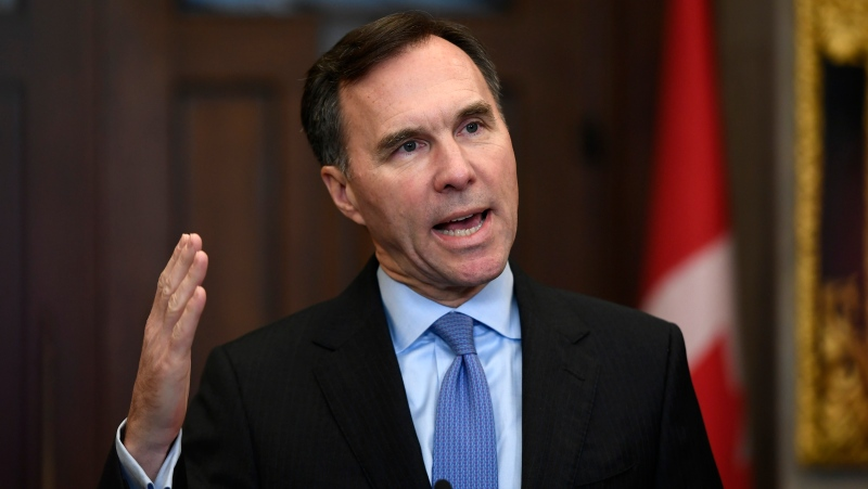 Minister of Finance Bill Morneau makes an announcement on lowering taxes for the middle class in the Foyer of the House of Commons on Parliament Hill in Ottawa, on Monday, Dec. 9, 2019. THE CANADIAN PRESS/Justin Tang