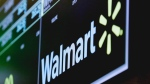 In this May 17, 2018, file photo the logo for Walmart appears above a trading post on the floor of the New York Stock Exchange. (AP Photo/Richard Drew, File)