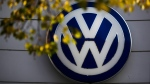 In this Oct. 5, 2015 file photo the VW sign of Germany's car company Volkswagen is displayed at the building of a company's retailer in, Berlin, Germany. (AP Photo/Markus Schreiber, File)
