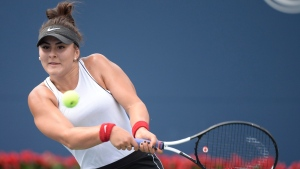 Canada's Bianca Andreescu returns to Serena Williams of the USA during the final of the Rogers Cup tennis tournament in Toronto on Sunday, Aug. 11, 2019. (THE CANADIAN PRESS/Nathan Denette)