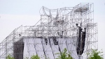 A collapsed stage is shown at a Radiohead concert at Downsview Park in Toronto on June 16, 2012. (THE CANADIAN PRESS/Nathan Denette)