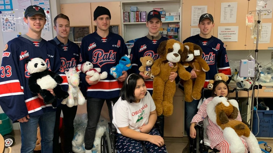 Members of the Regina Pats deliver stuffed animals to patients at the General Hospital. (Marc Smith / CTV News Regina)