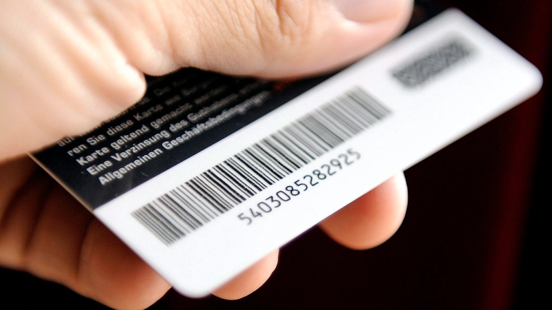 A man holds a customer card with a bar code in Gelsenkirchen, Germany, Thursday, Sept. 4, 2008. (THE CANADIAN PRESS / AP / Martin Meissner)