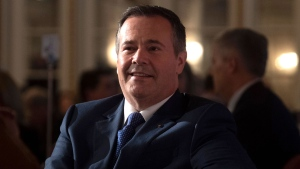 Alberta Premier Jason Kenney listens as he is introduced before speaking to the Canadian Club of Ottawa, Monday December 9, 2019 in Ottawa. THE CANADIAN PRESS/Adrian Wyld