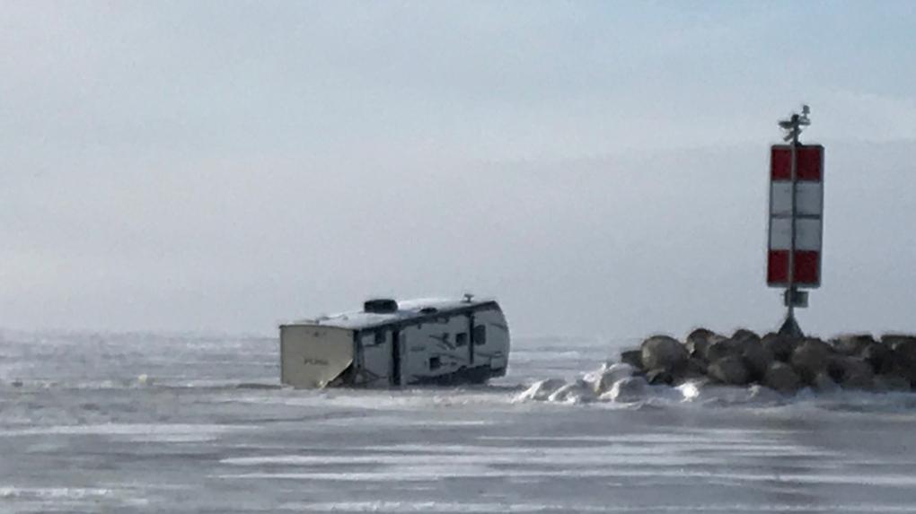 Trucks, trailer fall through ice on Lake Winnipeg