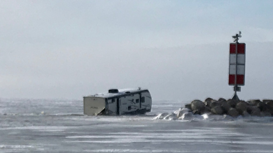 The Rural Municipality of St. Clements is urging people to keep their vehicles off the ice after five vehicles, including a truck and camper trailer, broke through the ice on Lake Winnipeg Sunday near Balsam Bay. (Source: Josh Crabb/ CTV News Winnipeg)