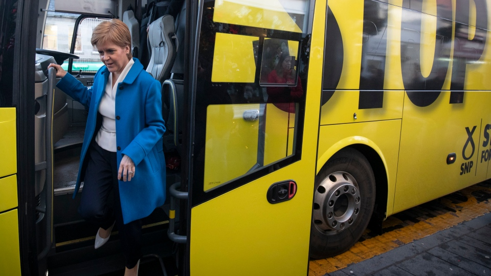 Scottish National Party (SNP) leader Nicola Sturgeon arrives for an election stopover on the General Election campaign trail in Lanark, Scotland, Monday Dec. 9, 2019. (Jane Barlow/PA via AP)