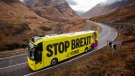 The SNP campaign bus travels along the Pass of Glencoe in the Highlands during its tour of Scotland in the final week of the General Election campaign, Monday Dec. 9, 2019. (Jane Barlow / PA via AP)