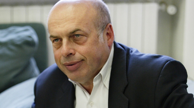 FILE - In this May 2, 2005 file photo, Natan Sharansky pauses during an interview with The Associated Press at his office in Jerusalem. (AP Photo/Oded Balilty, File)