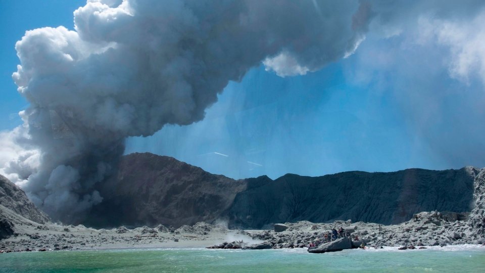 This Dec. 9, 2019, photo provided by Michael Schade, shows the eruption of the volcano on White Island, New Zealand. (Michael Schade via AP)