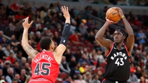 Toronto Raptors' Pascal Siakam (43) shoots as Chicago Bulls' Denzel Valentine defends during the first half of an NBA basketball game Monday, Dec. 9, 2019, in Chicago. (AP Photo/Charles Rex Arbogast)