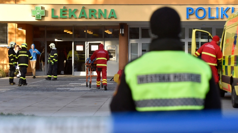 Firefighters, police officers and paramedics in front of the Ostrava Teaching Hospital, after a shooting incident in Ostava, Czech Republic, Tuesday, Dec. 10, 2019. (Jaroslav Ozana/CTK via AP)