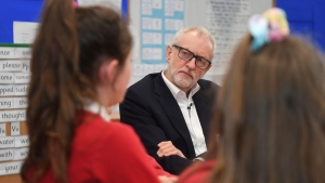 Britain's Labour Party leader Jeremy Corbyn visits Sandylands Community Primary School in Morecambe, north England, Tuesday Dec. 10, 2019, ahead of the general election on Dec. 12. (Joe Giddens/PA via AP)