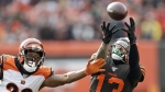 Cleveland Browns wide receiver Odell Beckham Jr. (13) can't hold onto the ball under pressure from Cincinnati Bengals cornerback William Jackson (22) during the first half of an NFL football game, on Dec. 8, 2019. (Ron Schwane / AP)