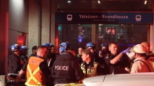 Rescue crews were at a downtown Vancouver Canada Line station Monday night after a man in a mobility scooter fell down an elevator shaft.
