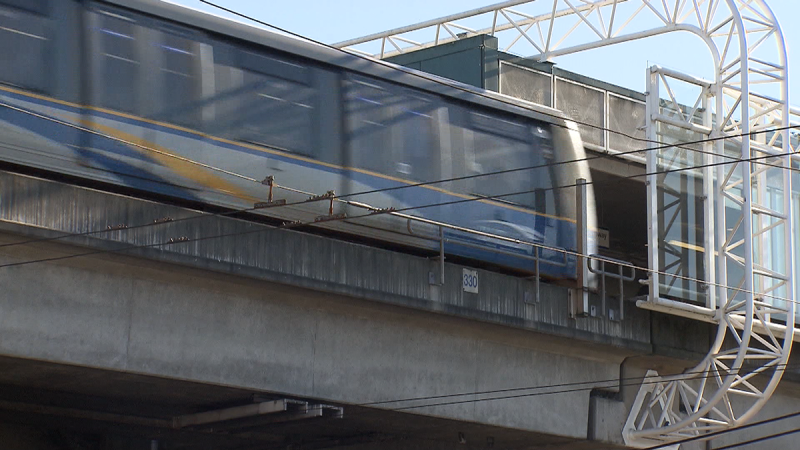 A SkyTrain passes through a station in this image from video.