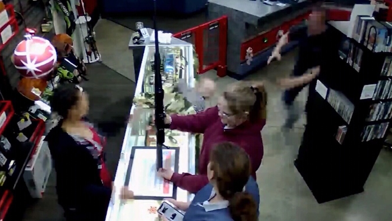 Store manager jumps into action to catch falling b