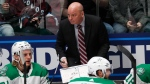 Dallas Stars coach Jim Montgomery draws up a play during a timeout in the first period of the team's NHL hockey game against the Colorado Avalanche on Friday, Nov. 1, 2019, in Denver. THE CANADIAN PRESS/AP/David Zalubowski