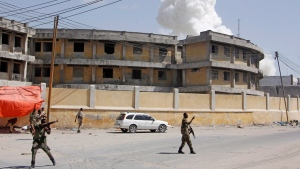 In this file photo, soldiers stand near the presidential palace in the capital Mogadishu, Somalia, Saturday, Dec. 22, 2018. (AP Photo / Farah Abdi Warsameh)