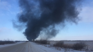 Smoke can be seen from the site of a CP train derailment near Guernsey, Sask. on Dec. 9, 2019. (Laura Woodward/CTV Saskatoon)