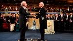 Austrian author Peter Handke, left, receives the 2019 Nobel Prize from King Carl Gustaf of Sweden, during the Nobel Prize award ceremony at the Stockholm Concert Hall, in Stockholm, Tuesday, Dec. 10, 2019. (Jonas Ekstromer/TT News Agency via AP)