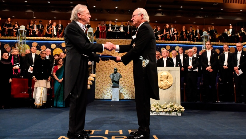 Austrian author Peter Handke, left, receives the 2019 Nobel Prize from King Carl Gustaf of Sweden, during the Nobel Prize award ceremony at the Stockholm Concert Hall, in Stockholm, Tuesday, Dec. 10, 2019. (Jonas Ekstromer/TT News Agency via AP)