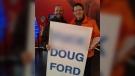 Ottawa Centre MPP Joel Harden stands beside a cardboard sign. (Reddit/bermaro1)