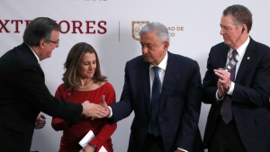 Mexico''s Foreign Minister Marcelo Ebrard, left, shakes hands with Mexico's President Andres Manuel Lopez Obrador, as Deputy Prime Minister of Canada Chrystia Freeland, second left, and U.S. Trade Representative Robert Lighthizer look on, during an event to sign an update to the North American Free Trade Agreement, at the national palace in Mexico City, Tuesday, Dec. 10. 2019. (AP Photo/Marco Ugarte)