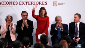 Deputy Prime Minister of Canada Chrystia Freeland, center, waves as Mexico's Foreign Minister Marcelo Ebrard, second left, Mexico's President Andres Manuel Lopez Obrador, second right, and U.S. Trade Representative Robert Lighthizer, right, look on during an event to sign an update to the North American Free Trade Agreement, at the national palace in Mexico City, Tuesday, Dec. 10. 2019. (AP Photo/Marco Ugarte)