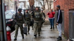Police officers arrive at the scene following reports of gunfire, Tuesday, Dec. 10, 2019, in Jersey City, N.J. AP Photo/Eduardo Munoz Alvarez)