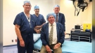 Health Minister Tyler Shandro poses with surgeons at the Southern Alberta Eye Centre as well as Stan Grad, an eye surgery patient, in Dec. 2019