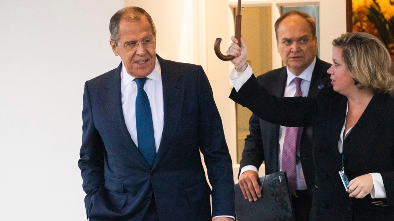 Russian Foreign Minister Sergey Lavrov, left, leaves the White House following a meeting with President Donald Trump, Tuesday, Dec. 10, 2019, in Washington. (AP Photo/Manuel Balce Ceneta)