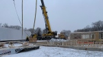 Construction crews install six pods at the site for the new Home for Hope Georgian Bay Cancer Support Centre in Penetanguishene on Tues., Dec. 10, 2019. (Craig Momney/CTV News)