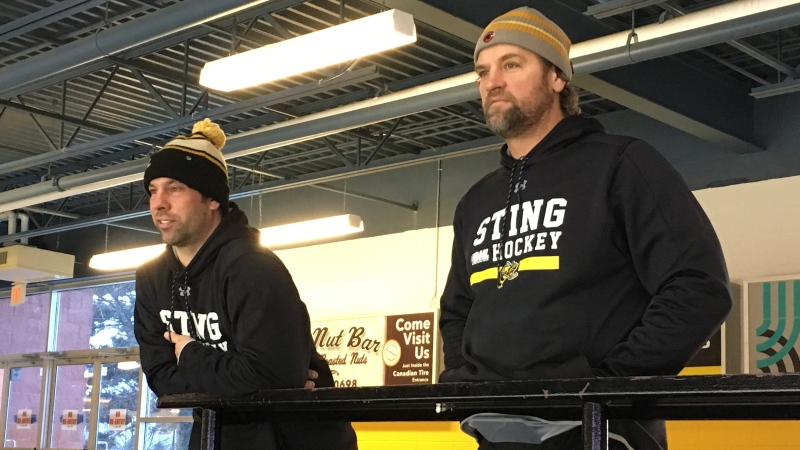 Sarnia Sting owners David Legwand, left, and Derian Hatcher watch practice in Sarnia, Ont. on Tuesday, Dec 10, 2019. (Brent Lale / CTV London)