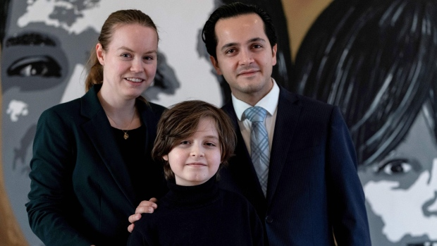 Laurent, pictured with his mother, Lydia, and father, Alexander. (KENZO TRIBOUILLARD/AFP via Getty Images via CNN)