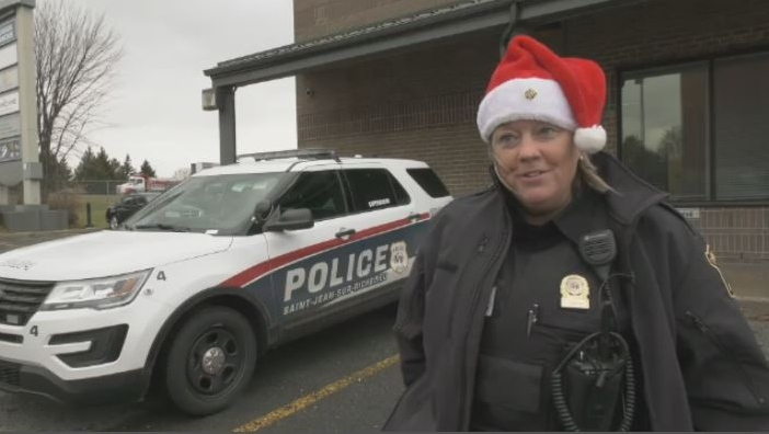 A St-Jean-sur-Richelieu police officer wears a Santa hat on Dec. 10, 2019.
