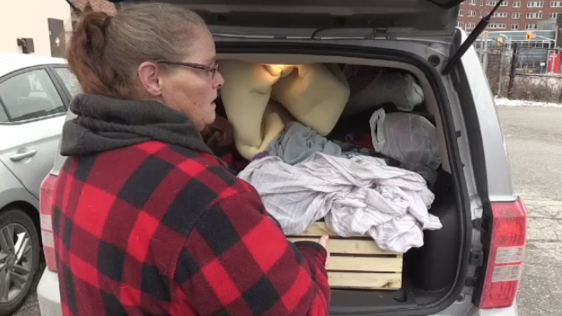 Dawn Saxon seen here with her belongings packed into her car. She lost her truck--which is where she lived--when the company she worked for closed suddenly.