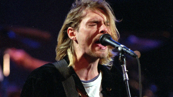 Kurt Cobain, lead singer for the Seattle-based band Nirvana, performs during the taping of MTV's Live and Loud Production in Seattle, on Dec. 13, 1993. (AP / Robert Sorbo)