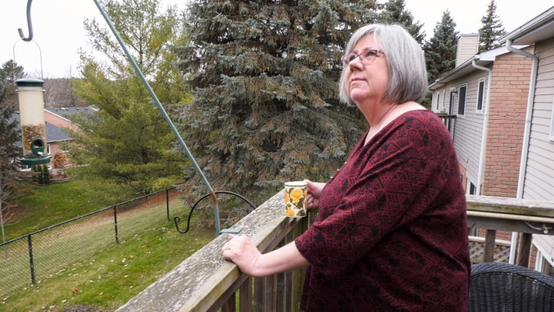 Aileen Moxley stands outside her home in Uxbridge, Ont. She says she's unsure if she will be able to stay in her home after her family's mortgage insurance expired.